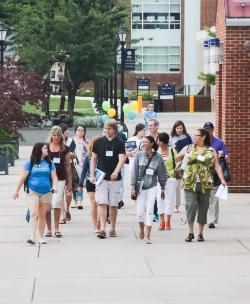 Student group walking on campus at orientation