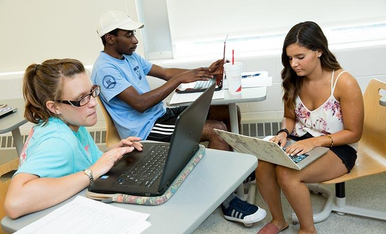 Longwood students working on a group project