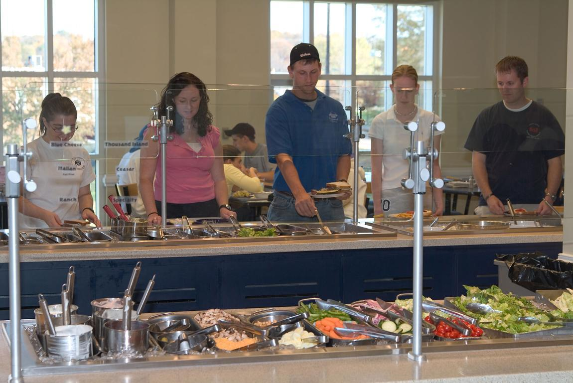 Students at the salad bar in dhall