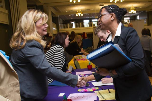 Longwood student meeting an employer at the Education Job Fair