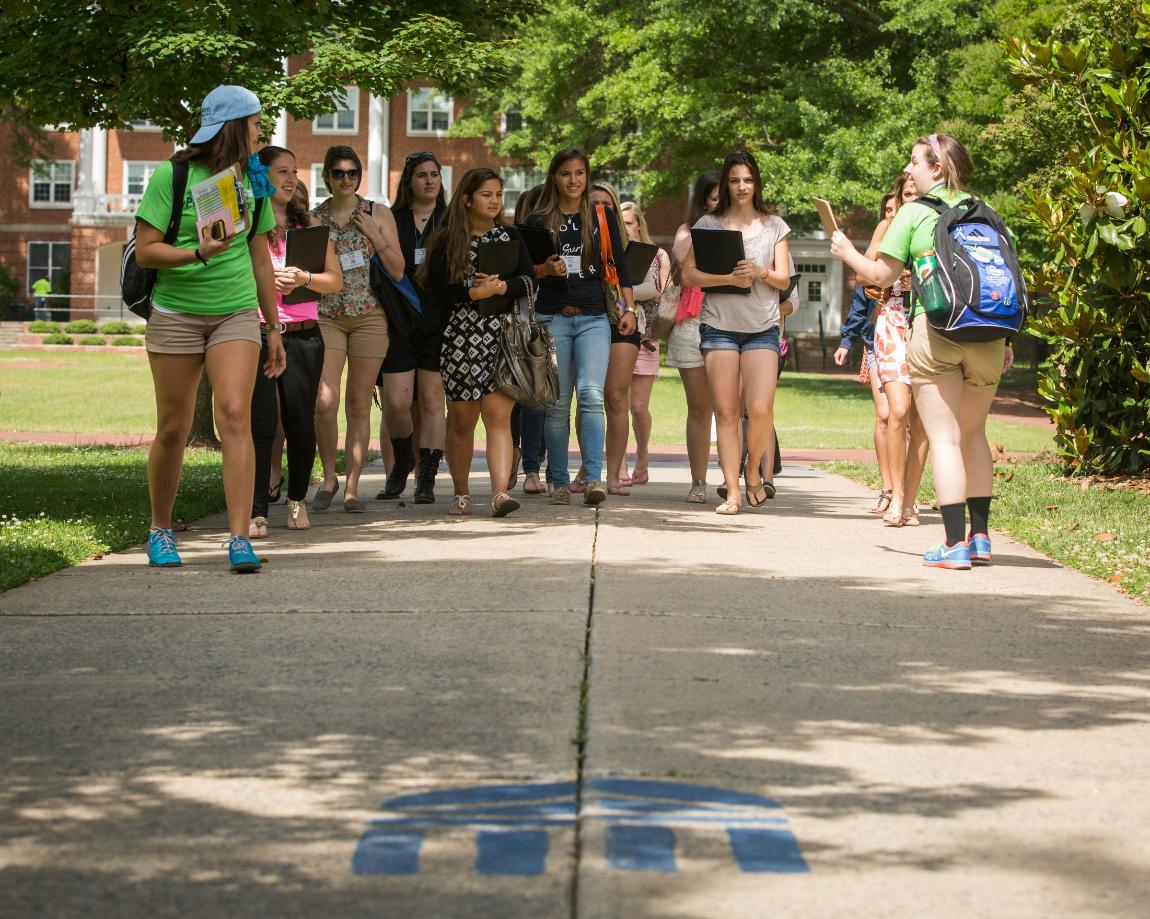 Group touring campus with peer mentors for orientation