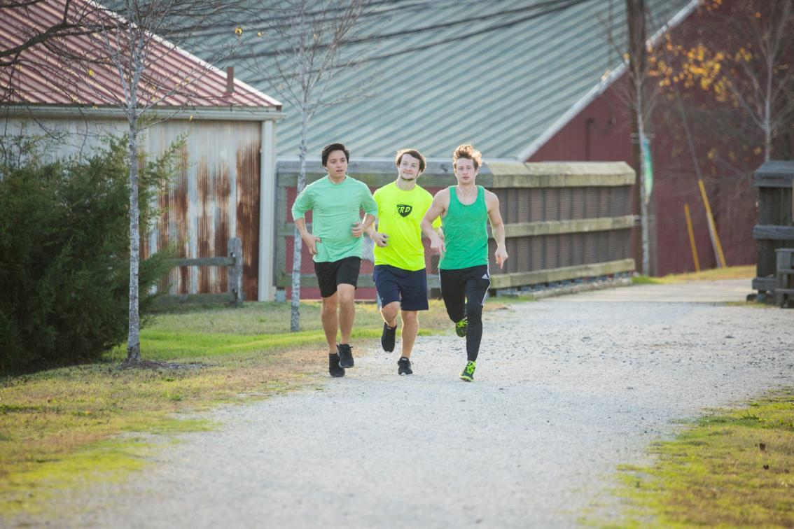 Three people running on High Bridge Trail
