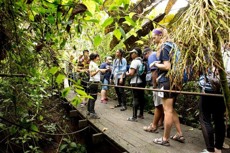 LU student group in Costa Rica on a bridge with greenery