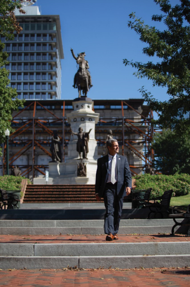 As director of Virginia's Department of General Services, Joe Damico '85 has wide-ranging responsibilities, including the construction of the new General Assembly Building, visible here in the background behind the Washington statue.