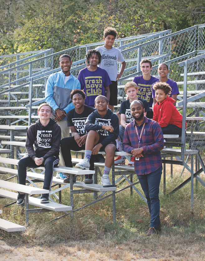 Louis Gould '19 (standing, lower right) founded the Fresh Boyz Club, whose mission is to help young men grow into community leaders (Photo by Courtney Vogel).
