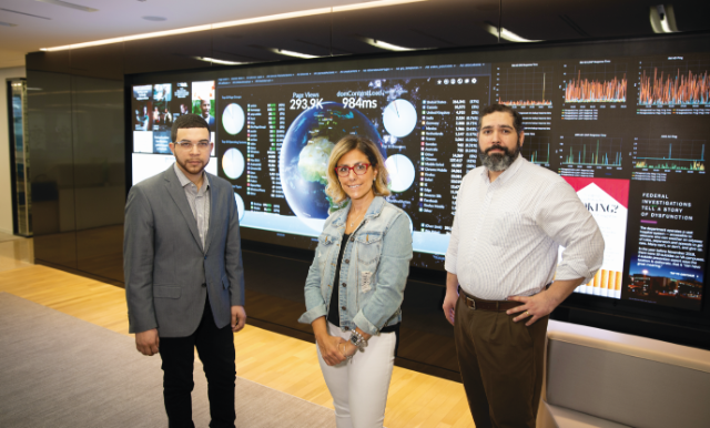 The iconic Washington Post newsroom, made famous in the 1976 film All the President's Men, has been transformed into a modern multiplatform information hub featuring a digital media wall that tracks website and social media analytics in real time. Longwood alumni Travis Lyles (left), Anna Knapp and Anthony J. Rivera are playing a role in the news company's resurgence.