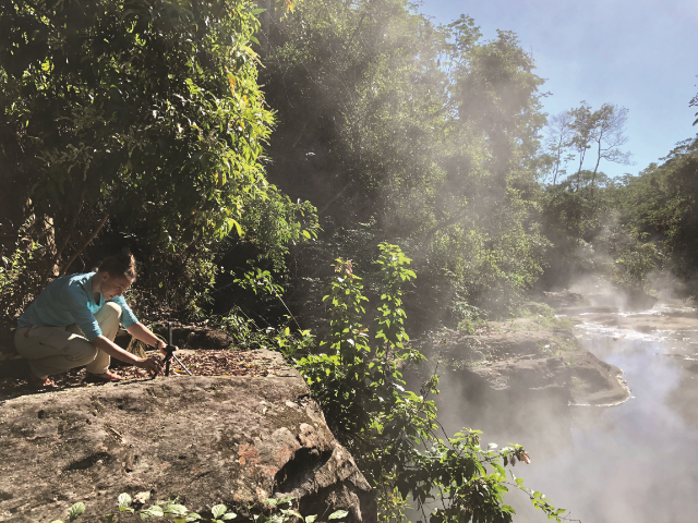 Becky Schnekser stages a 360- degree camera to collect images and videos of Shanay-Timpishka, a boiling hot thermal river in the Peruvian rainforest. (Photo courtesy of Wesley Della Volla)