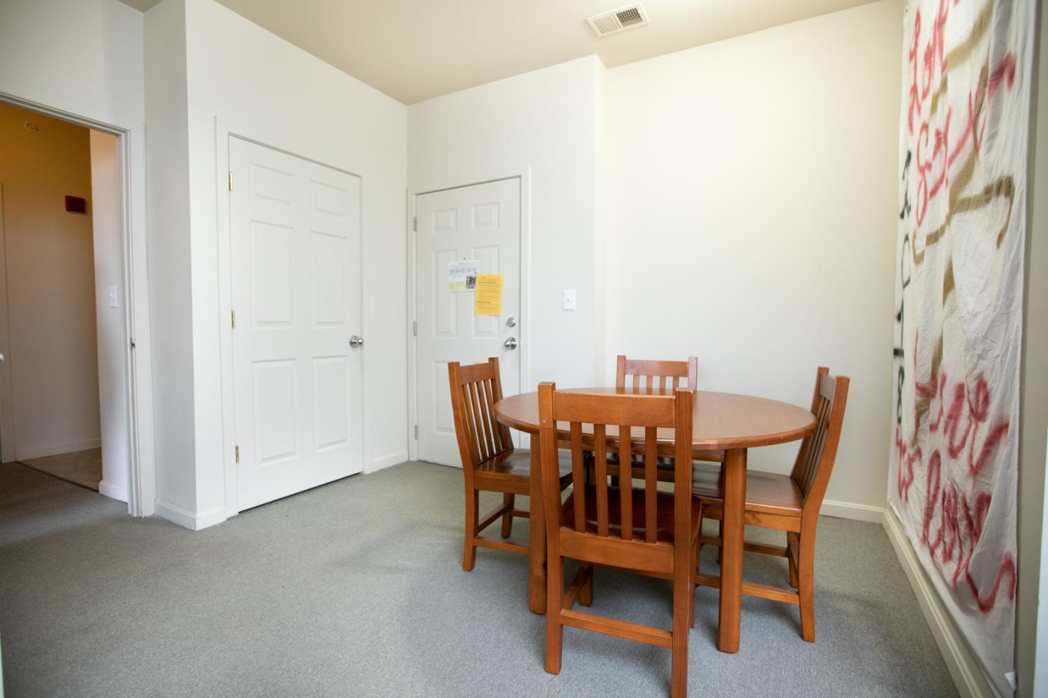 Longwood Landings 4 Bedroom Apartment; Entry way with dining table and 4 chairs