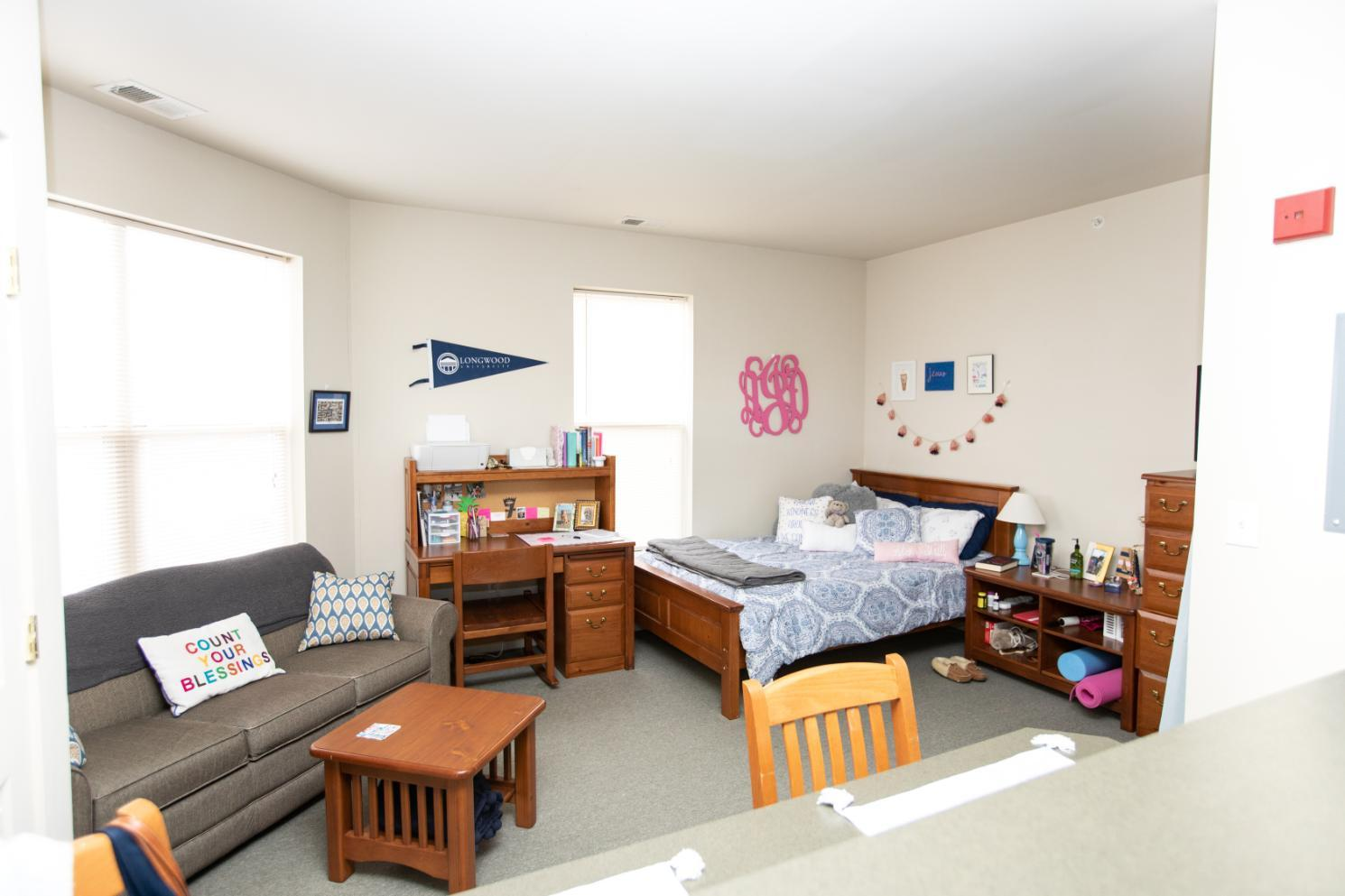 Longwood Landings Studio Apartment; view of bed and living area from the kitchen