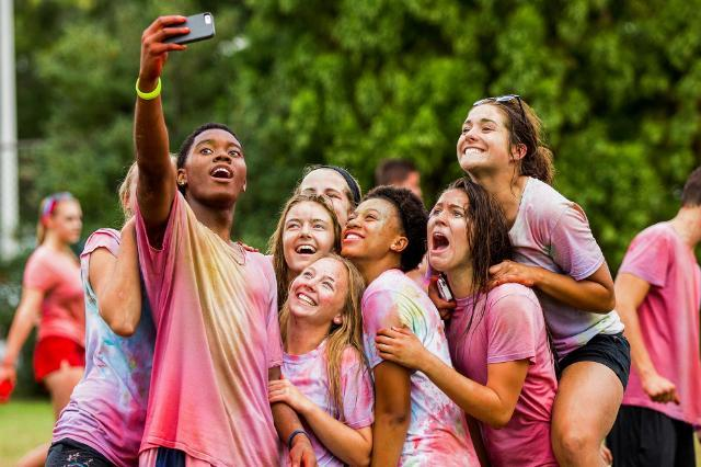 Students take a selfie after Color Wars battle