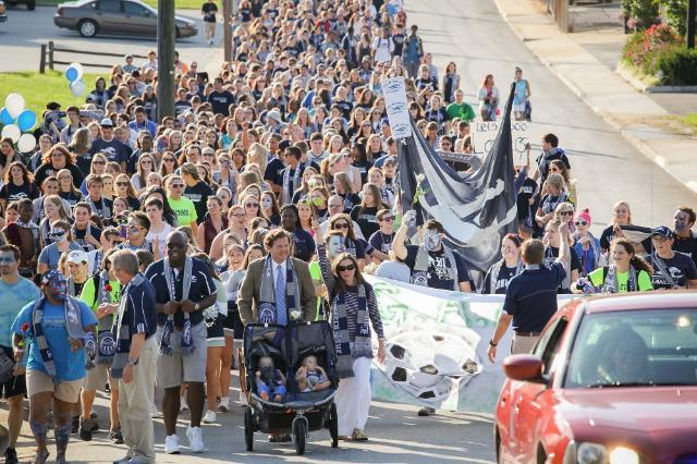 The Longwood community marching up to the Athletics Complex as part of The G.A.M.E.