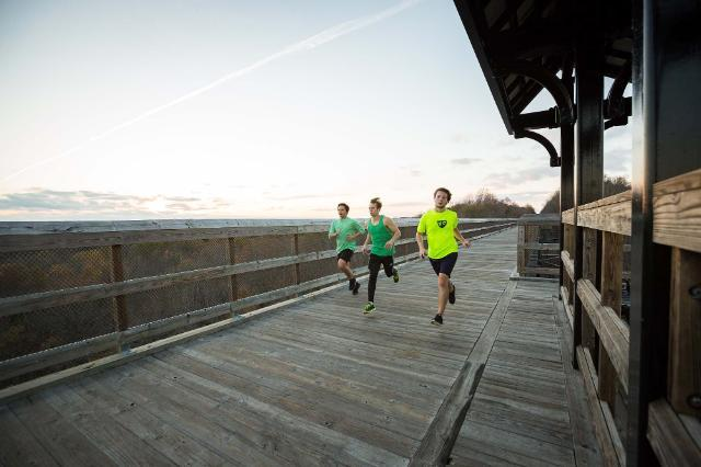 Longwood students running on High Bridge