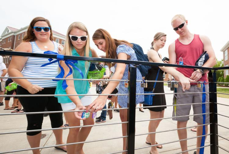 Students attach locks as part of a tradition that began in 2015