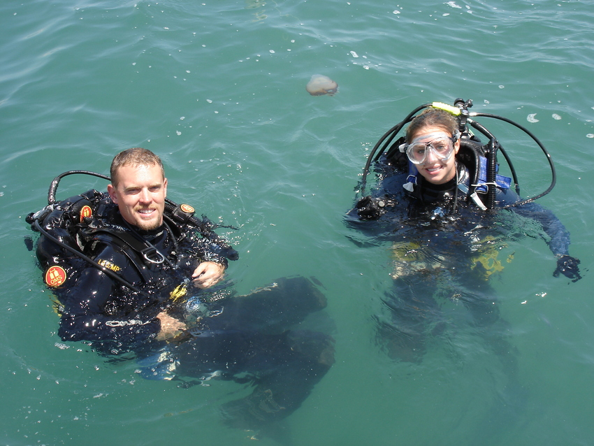 Molly Trivelpiece '15 and Brendan Burke '03 prepare for underwater archaeology