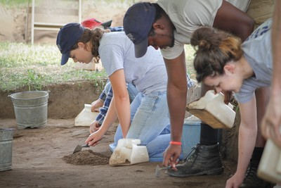 Students working at the archaeology field school