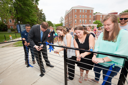 President Reveley and Longwood seniors add their locks in a new tradition.