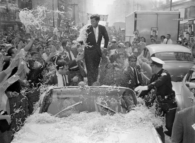Sen. John F. Kennedy is deluged with confetti and paper streamers as his car moves slowly up Broadway in downtown Los Angeles, Nov. 1, 1960. The Democratic presidential nominee got a wild welcome as he began a final quest for California's 32 electoral votes. (AP Photo/Dick Strobel)