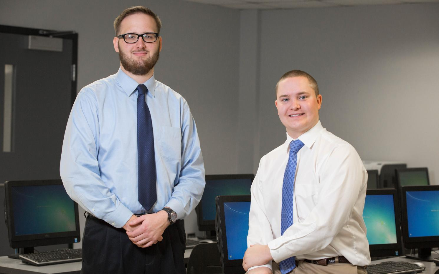 Cyber security scholarships that Tyler Chuba '18 (left) and Michael Moore '18 recently received from the state will aid their career plans.
