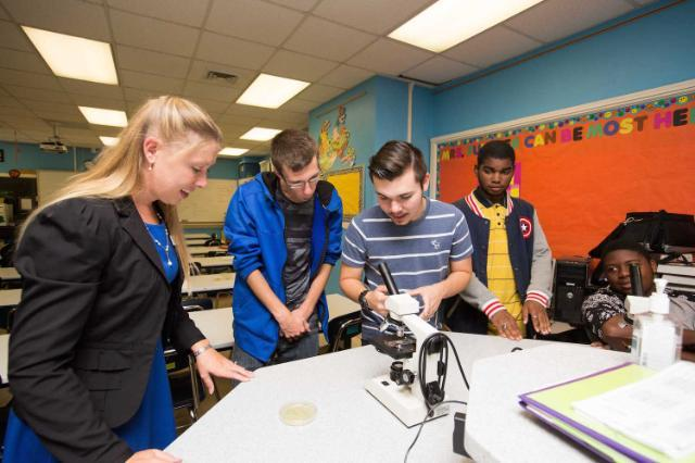 Dr. Amorette Barber, assistant professor of biology at Longwood, working with Prince Edward County High School students as they explore their local environment on a molecular level.