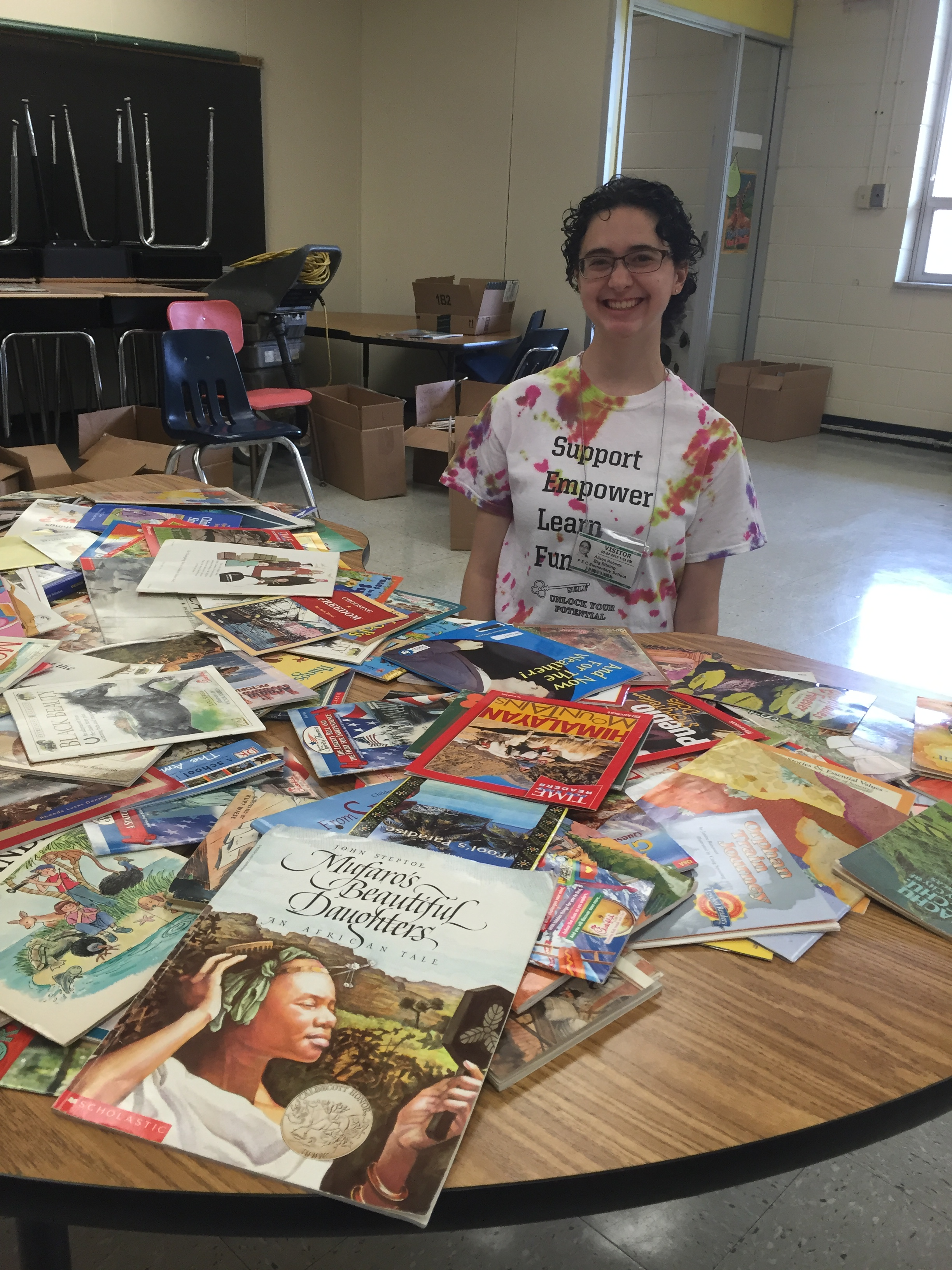 Alison Roberts '17 with books the SELF group donated to PECES