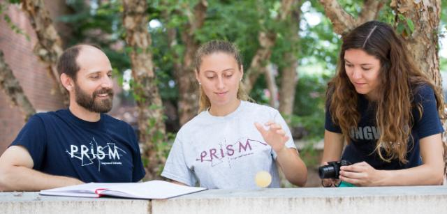 Rebecca Skelton '18 drops a rubbery egg while Chelsea Dandridge '17 photographs the experiment and physics professor Dr. Kenneth Pestka II Iooks on.