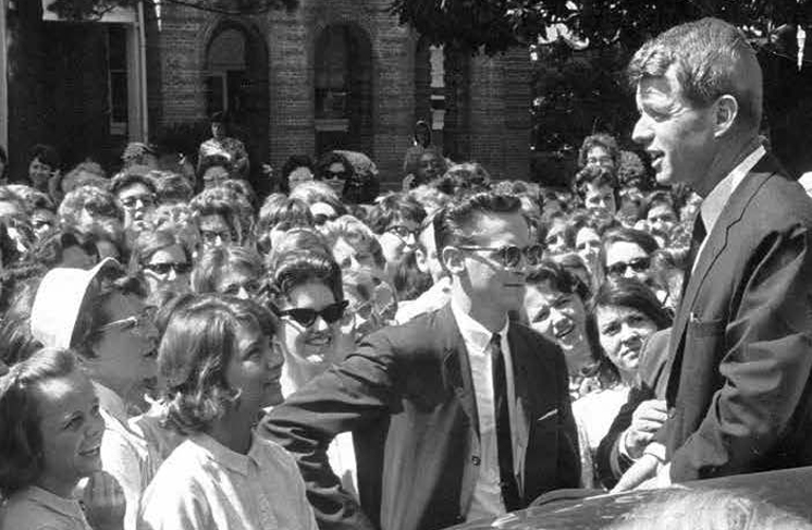 Attorney General Robert F. Kennedy stops to speak to Longwood students on High Street, 1964.