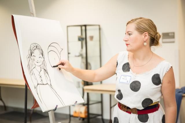 Illustrator Sophie Blackall draws during a presentation to school groups at the 2015 Virginia Children's Book Festival. Blackall won the 2016 Caldecott Medal for illustrations in the book Finding Winnie