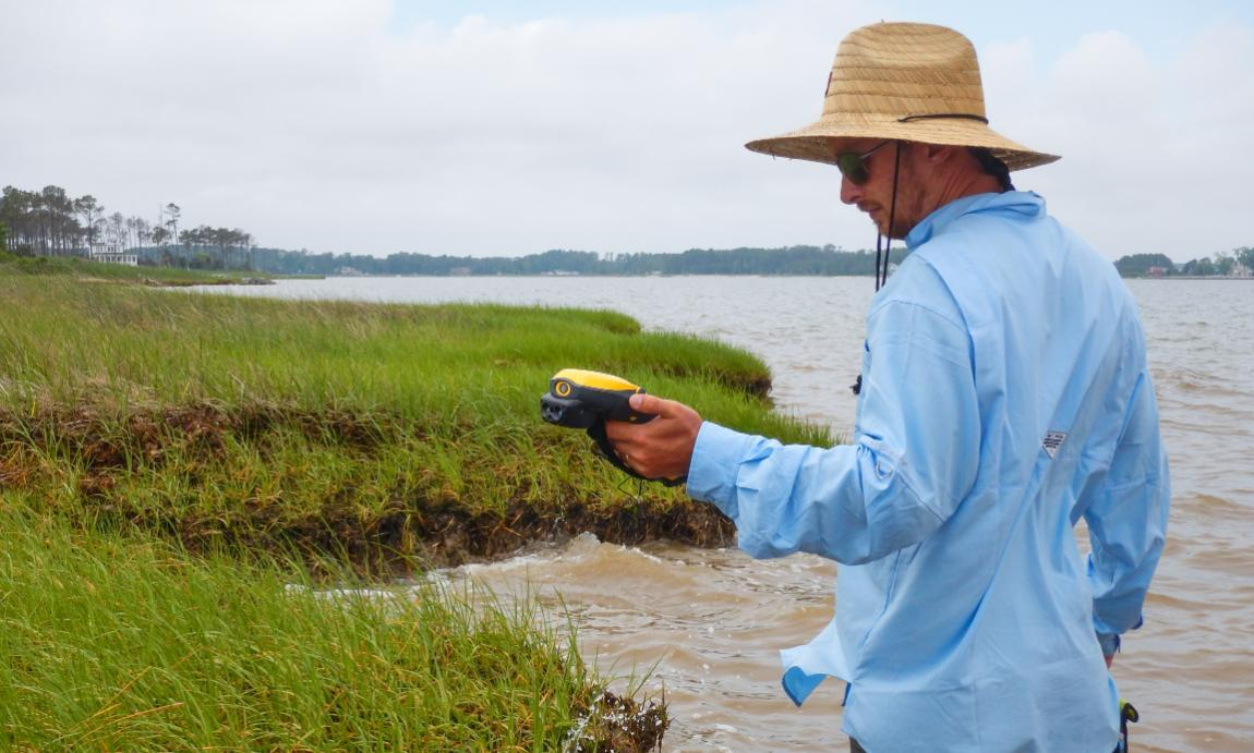Craig Rose '00 of the Longwood Institute of Archaeology maps a Mathews County shoreline with a high-accuracy GPS.