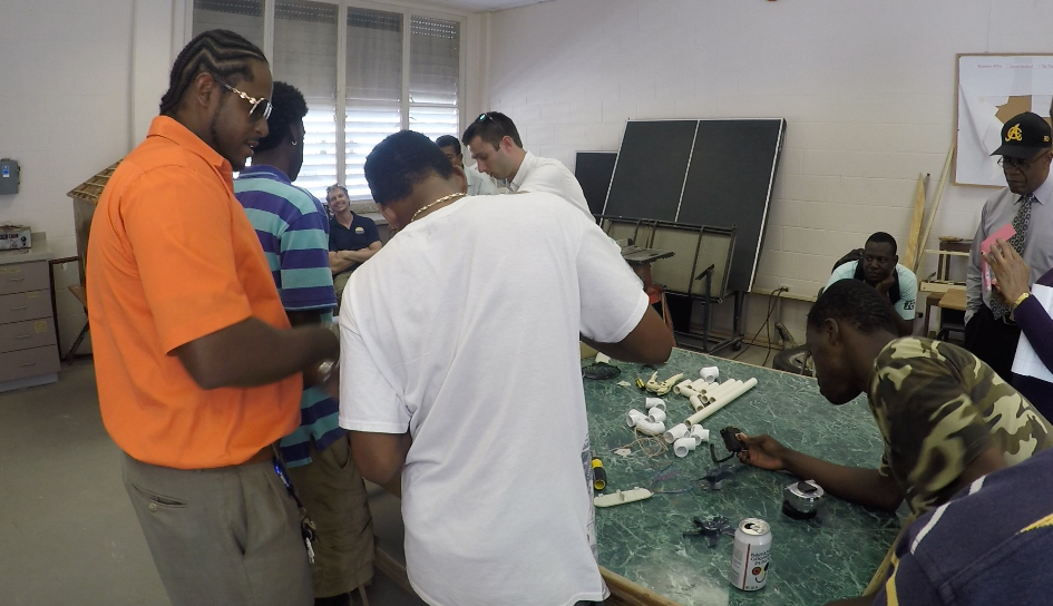 Then-Longwood student Garrett Josemans leads a class on wind turbines at a community college on the island of Grand Turk during a trip to the Caribbean with Dr. Chuck Ross.