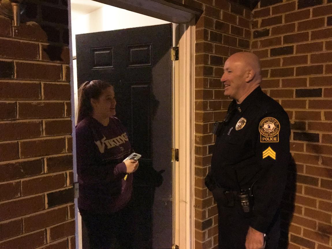 Sgt. Greg Giuriceo talks with Lindsey Kelly at Lancer Park after clearing her apartment the Thursday night of Spring Weekend.