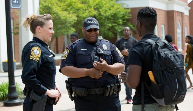 LUPD officers Rachel Whitehead and Quincy Steele chat with senior biology major Samuel McClain on Brock Commons. Officers stand out on Brock Commons most days at 1:45 p.m. to chat and get to know students.