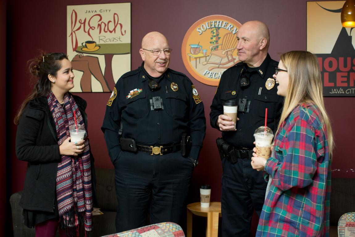 LUPD Chief Bob Beach (second from left) chats with students in Greenwood Library. During his monthly Coffee with the Chief, Beach buys students coffee and listens to their concerns in an effort to build trusting relationships with the campus community.
