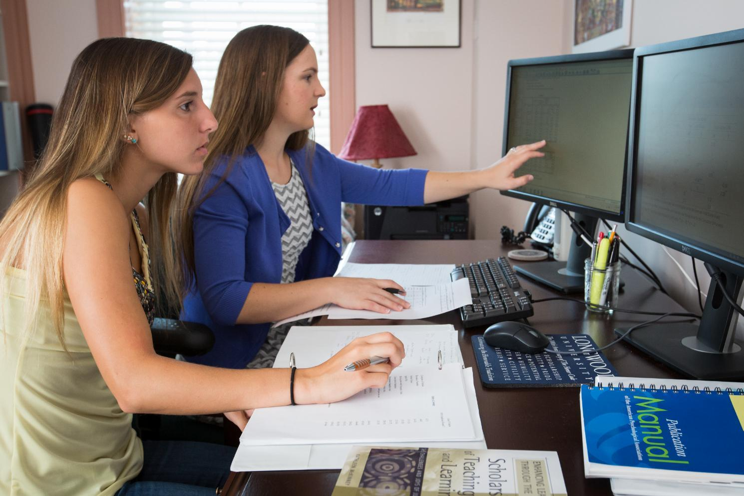 Student Gina D'Orazio '17 (L) and Dr. Sarai Blincoe (R) explore outcomes related to Academic Entitlement as part of the PRISM program