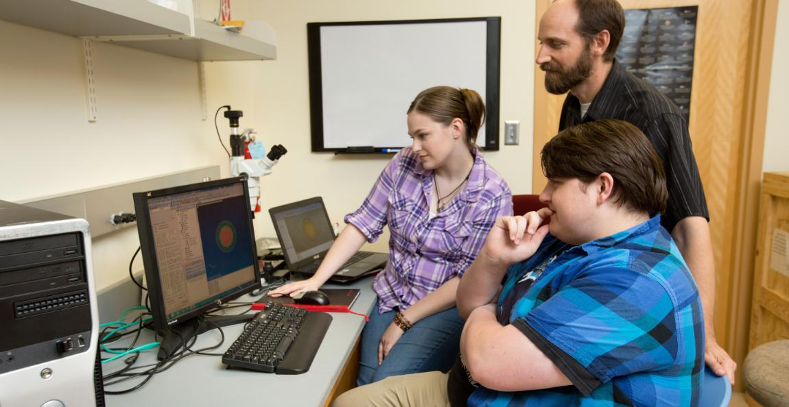 Laura Deale '17, Bob Highley '18 and Dr. Kenneth Peskta II examine one of Highley's just created three-layer models of a white dwarf star, part of a research project.