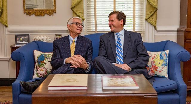 W. Taylor Reveley III, president of the College of William & Mary, and his son, W. Taylor Reveley IV, president of Longwood University, enjoy a visit in Williamsburg. (Credit: Skip Rowland)