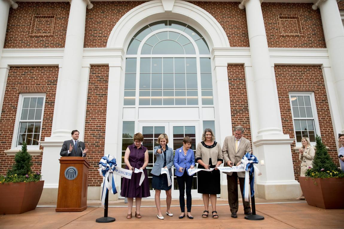 Joan Brock '64 (center) was joined by her daughters, Kathryn and Christy (far left and second from left), as well as Dr. Jennifer Green (second from right), associate vice president for enrollment management and student success, and Project Manager Bob Chambers (far right) in cutting the ribbon to officially open Brock Hall.