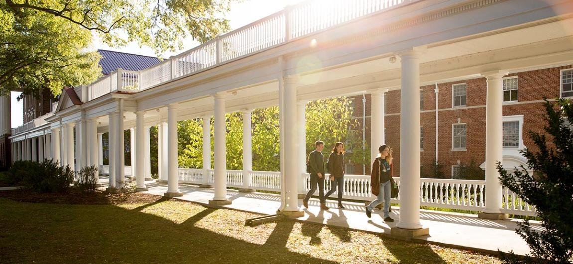 Students walking through colonnades on Longwood's campus