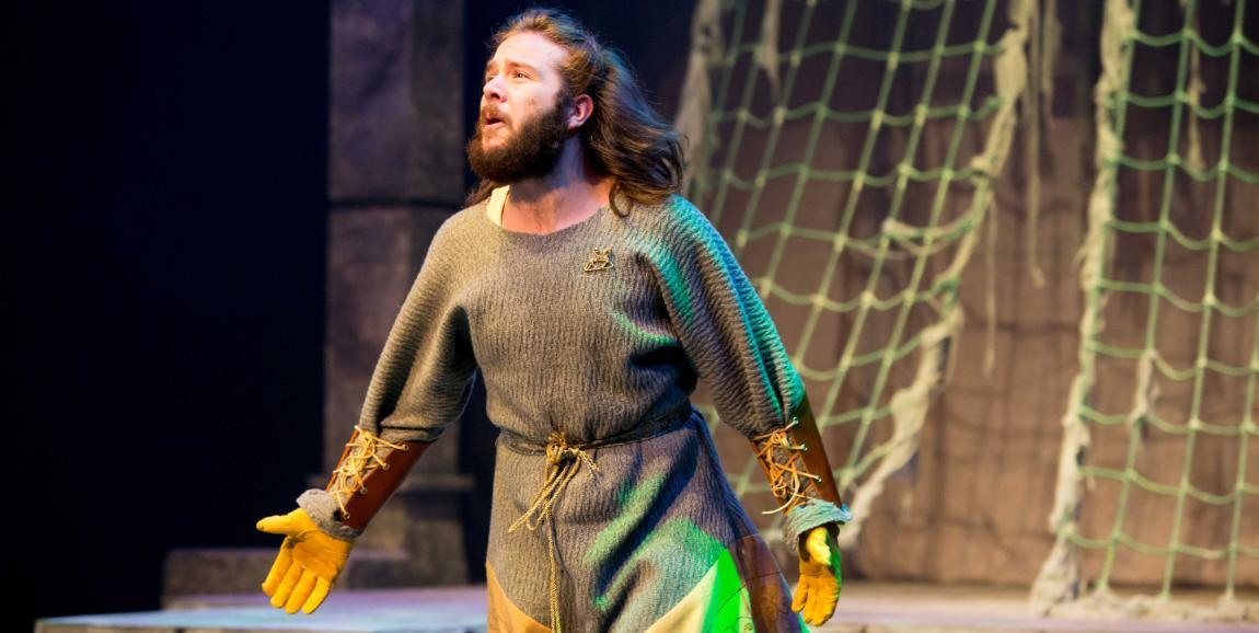 Student performing in 2017 production of Macbeth