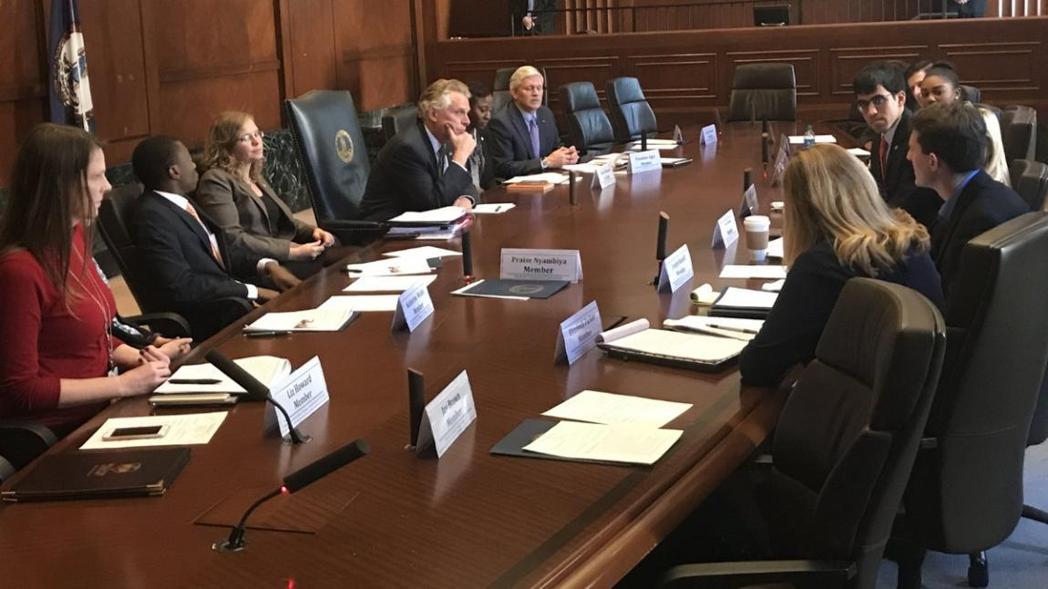 Longwood senior Praise Nyambiya sits with then-Gov. Terry McAuliffe as the Governor's Millennial Civic Engagement Task Force delivers its recommendations in December.