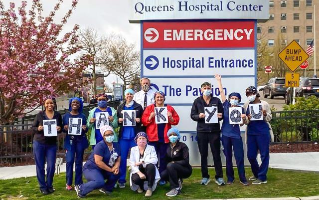 Kris Johnson '06 (holding the N) with some of her fellow nurses who traveled to New York City to aid in fighting the Covid-19 pandemic this spring. They are pictured in front of Queens Hospital Center with their bus driver, who drove them back and forth from their hotel to the hospital for their shift each day.