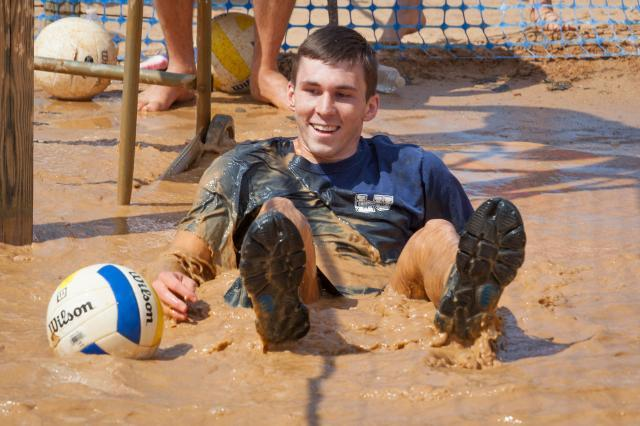 Student in the mud playing oozeball