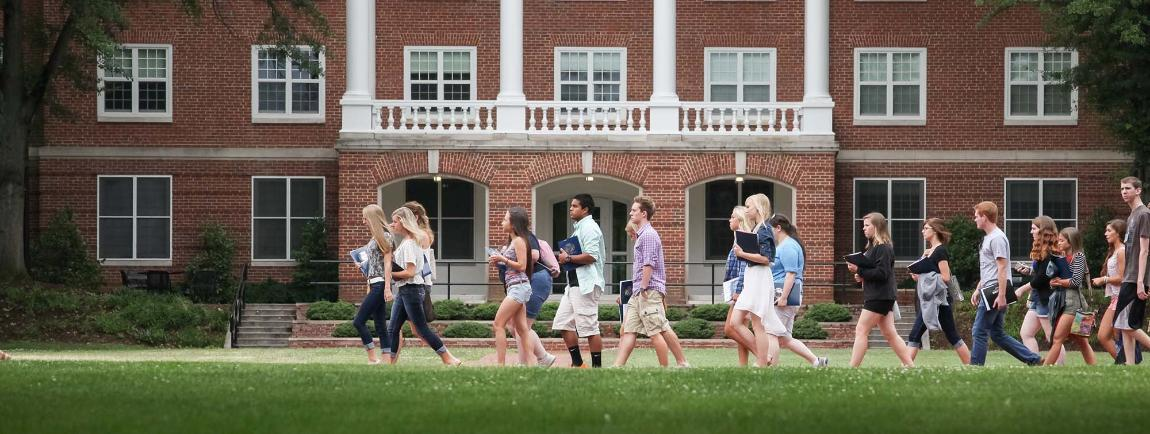 Students walking on campus during orientation