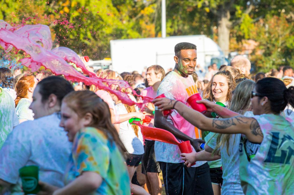 Students throwing paint at Longwood's Color Wars Event