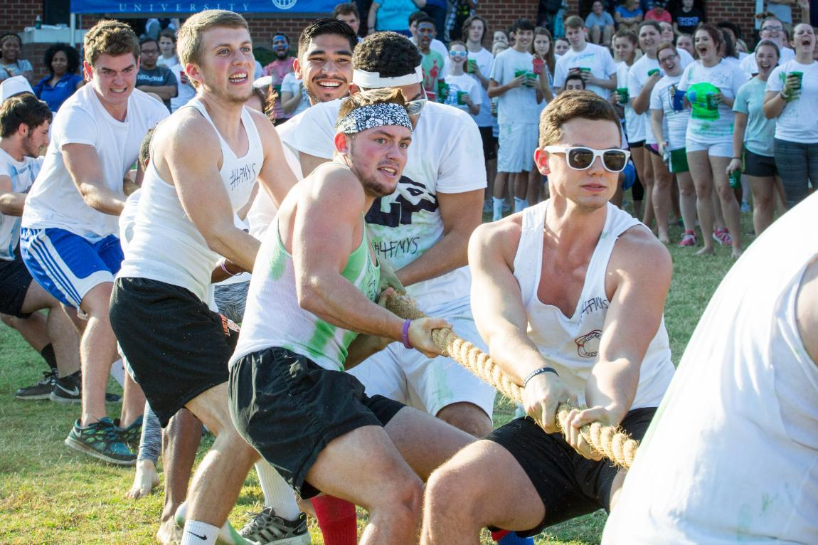 Men playing Tug-of-War at Longwood's Color Wars event