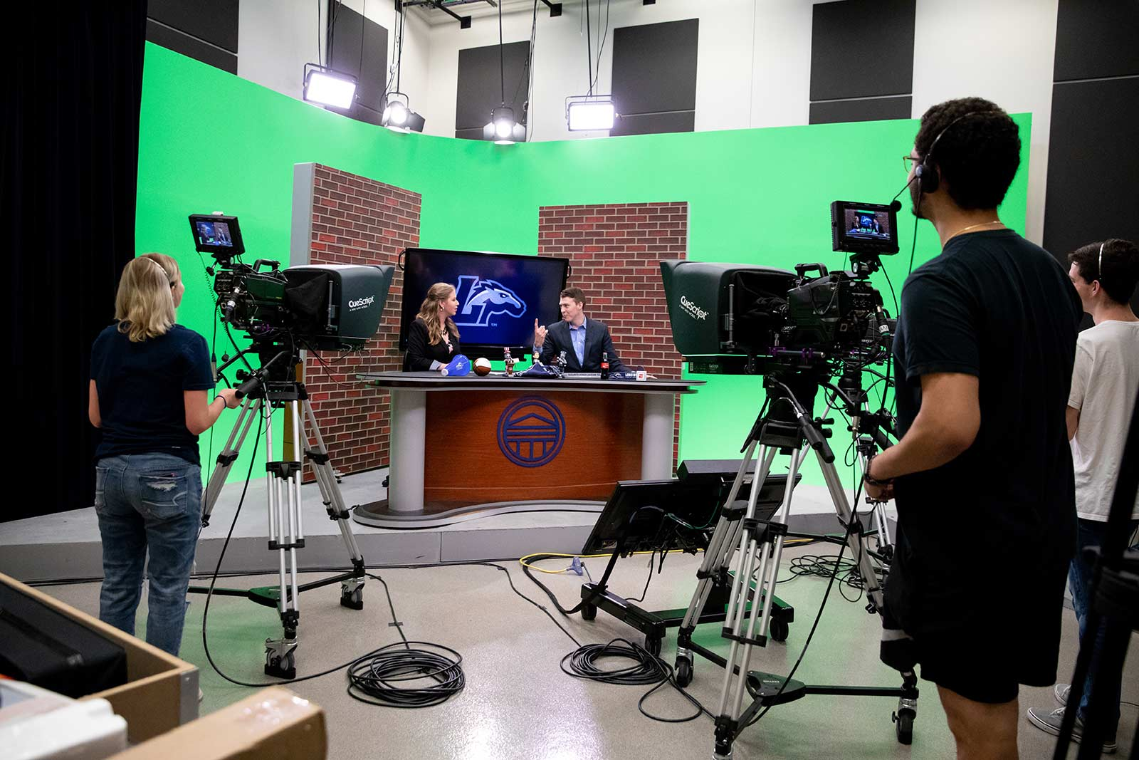 Practical experiences lead to the best learning—at least that's what we've figured out in our communication studies classrooms. Students studying broadcast media produce a weekly news show to keep everyone in the loop.