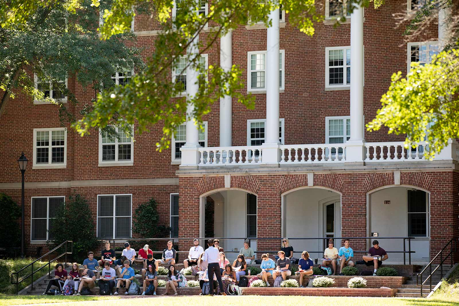 Few faculty members can resist holding classes outside under the giant oaks during perfect spring and fall days.