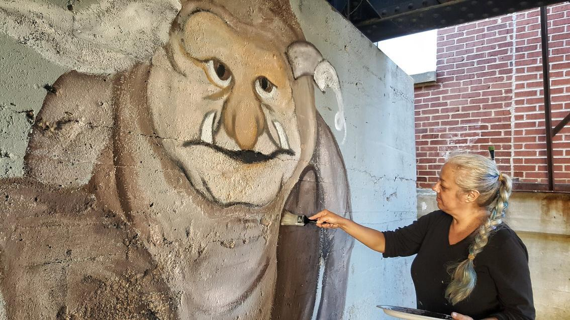 Audrey Sullivan painting Troll Mural
