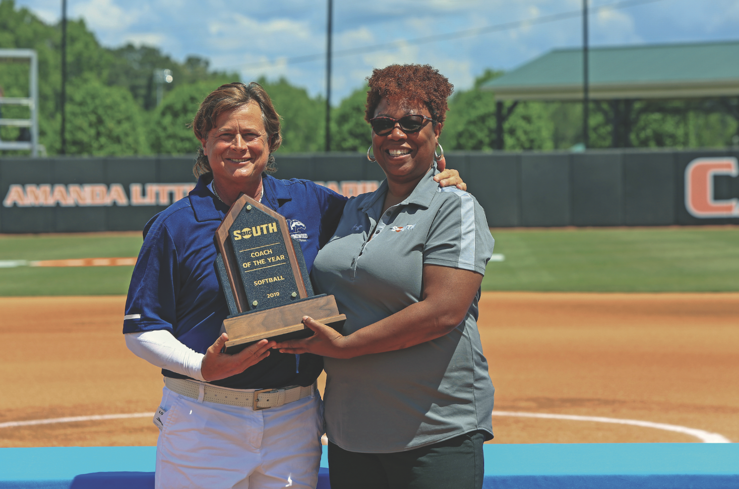 Softball coach Kathy Riley (left)
