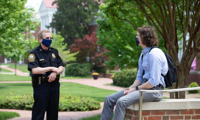 Chief Doug Mooney '86 talks with a student on campus